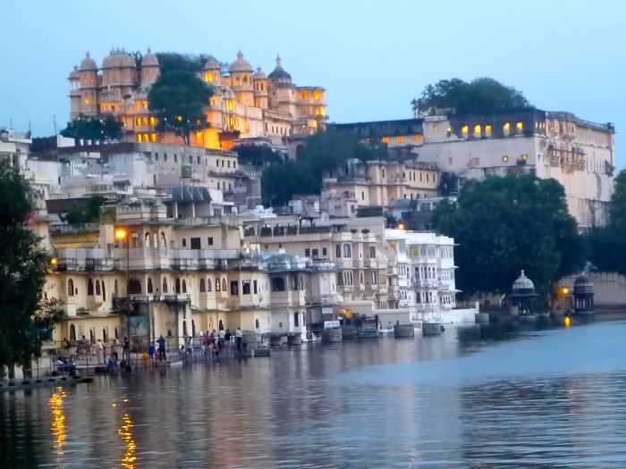 The brightly lit City Palace of Udaipur