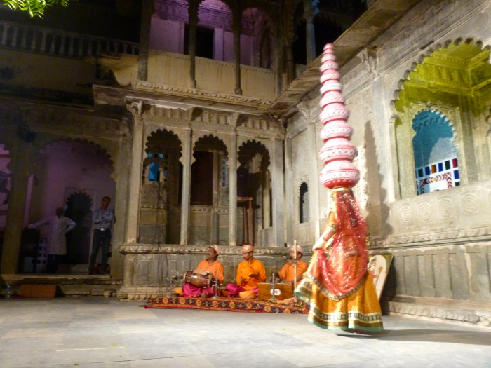 A cultural show in Udaipur. Count 'em: 9 separate pots carried on her head!