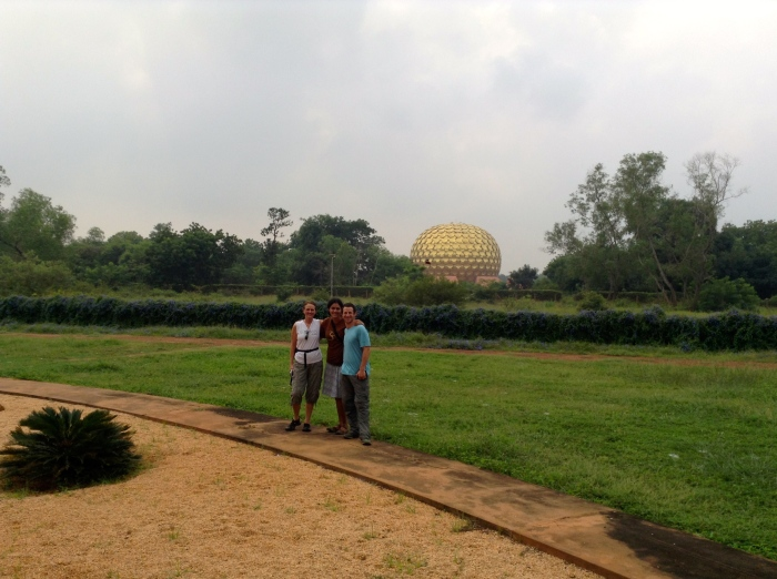 Us in front of the Matrimandir, the physical and spiritual center of Auroville
